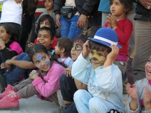 The tiger face-painted boy who steals the show.