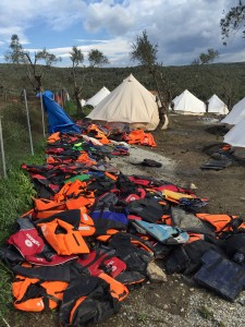 Hundreds of abandoned lifejackets line the fence outside Moria Refugee Camp, Lesvos, Greece.