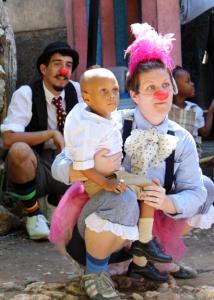 Kolleen sits with boy. Haiti