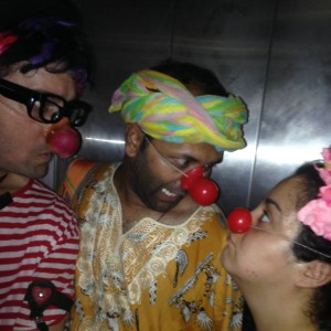 Clowns Gaby and Noah with Wishall. All three clowns make silly faces wearing the red nose.