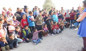Audience of children and adults laughing with the clowns on Lesvos. pictures