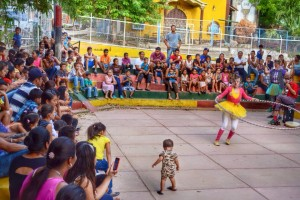 large audience watches performance held at school grounds