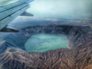 view of crater lake from airplane window