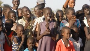 laughing children enjoy the clown performance at kakuma refugee camp