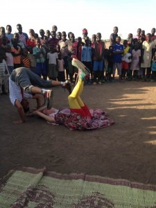 two clowns double summersault at kakuma refugee camp