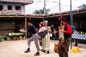 Four clowns perform at a village in Ecuador.