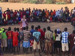 Kakuma refugee camp. Clowns perform for an audience of hundreds.