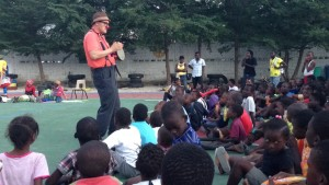 Chris Eyes Yerlig performs for 170 children at sakala community center