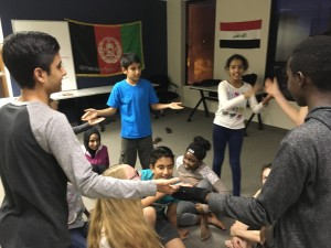 refugee children working on mime activities together in a group