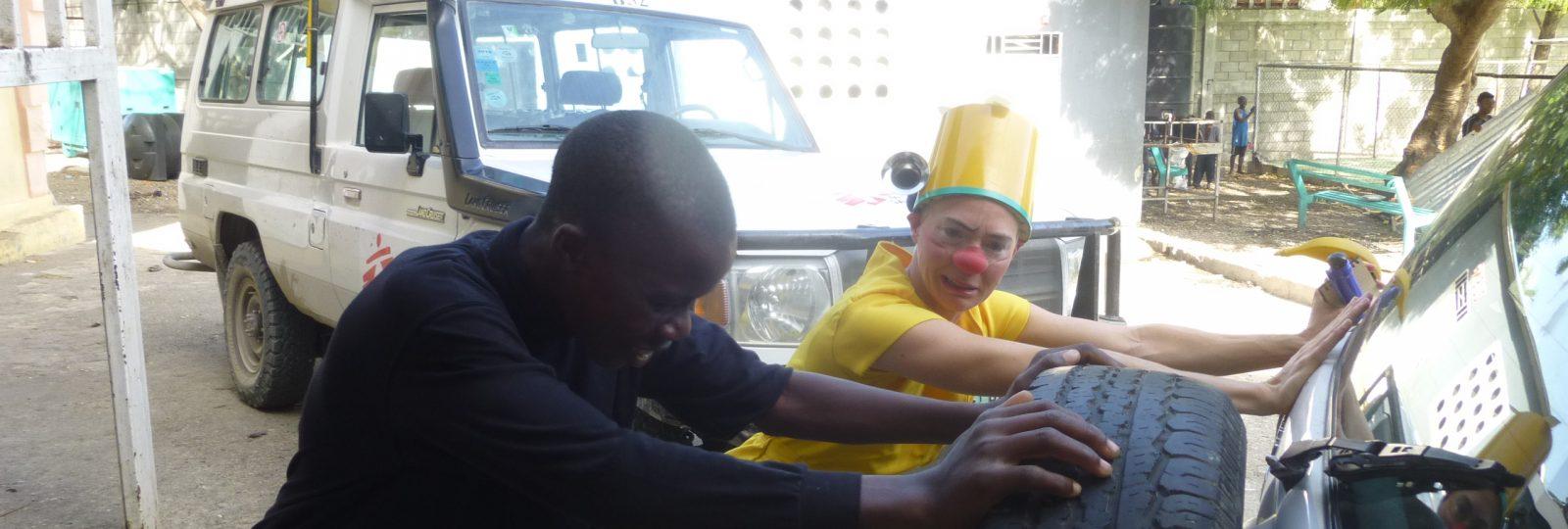 clown pushes a car
