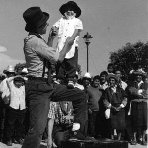 Andres holds up a toddler boy at a late 1980s performance in Chiapas. Celebrating our 100th project