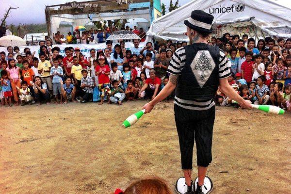 clown performs in refugee camp in jordan