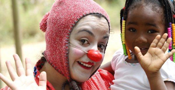 clown holds child