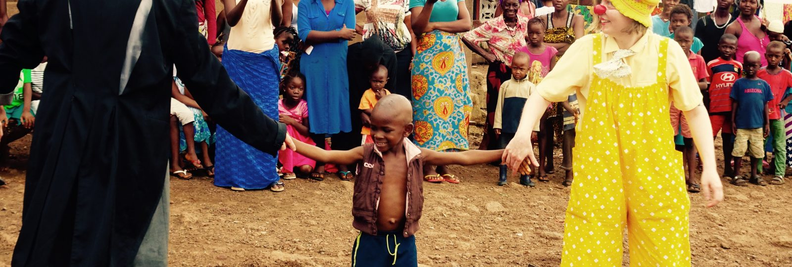 2 clowns and child in sierra leone