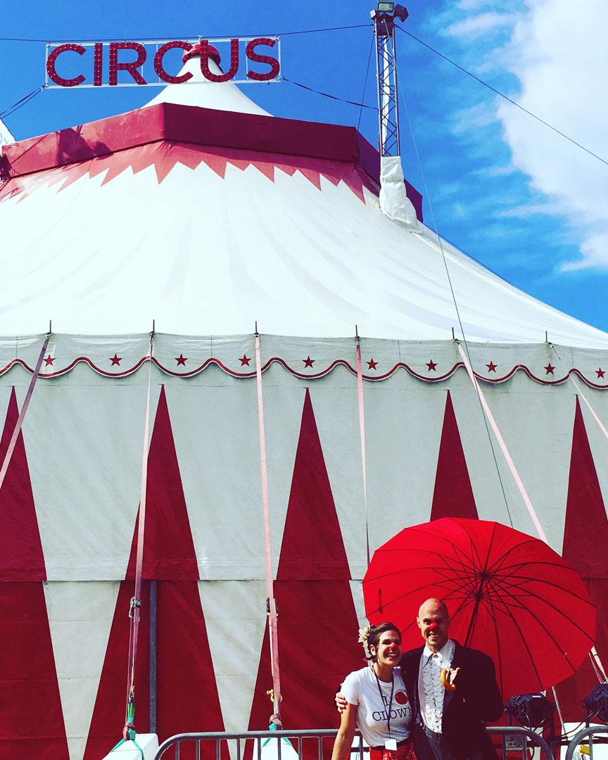 Clowns In Front Of Big Top