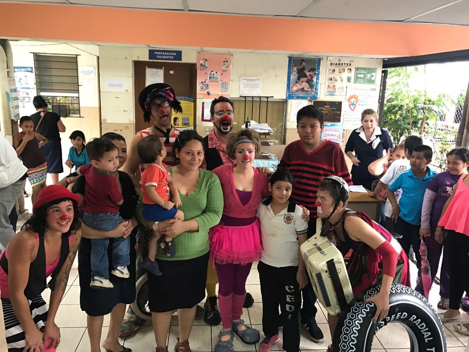 Clowns and locals in the health clinic