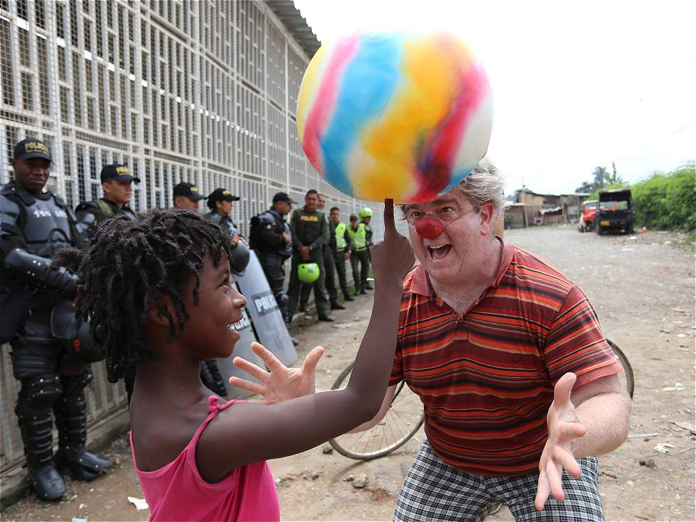 Clown performs in front of police in Colombia