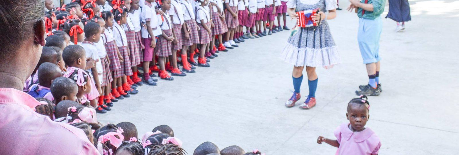 Clowns perform for girls in Haiti 2017