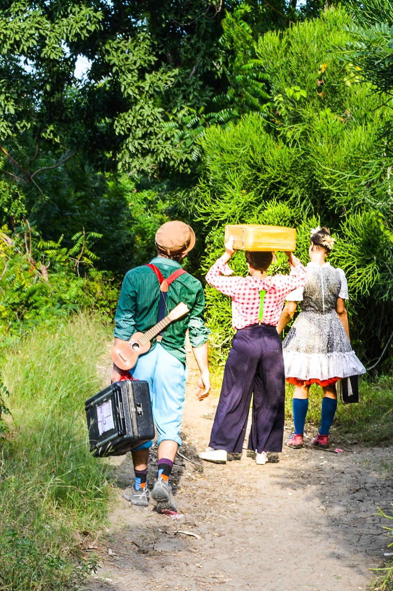 Three clowns walk into the jungle in Haiti