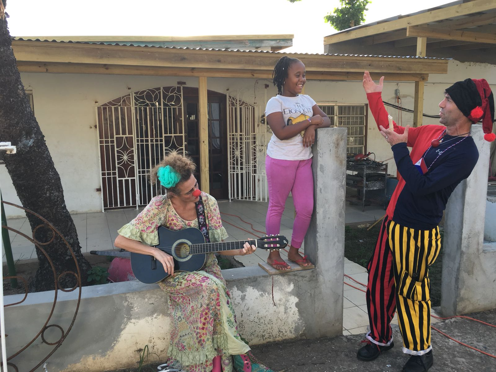 Clowns serenade a resident of St. Maarten