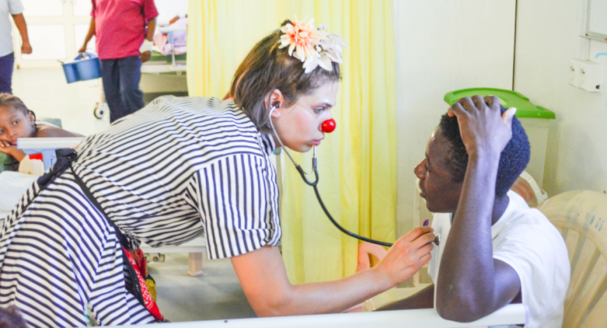 Naomi listens to a patient's heartbeat with her stethoscope