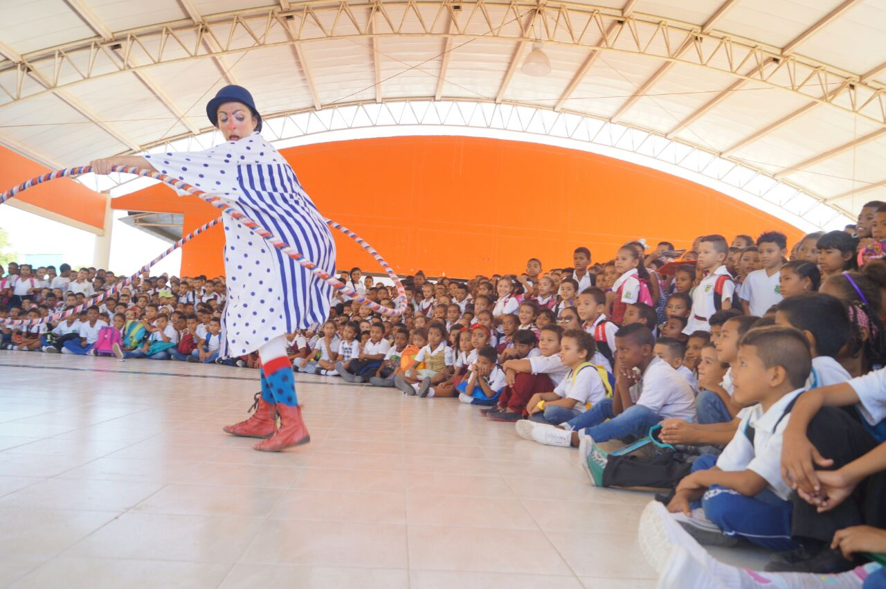 A clown spins a giant hoop