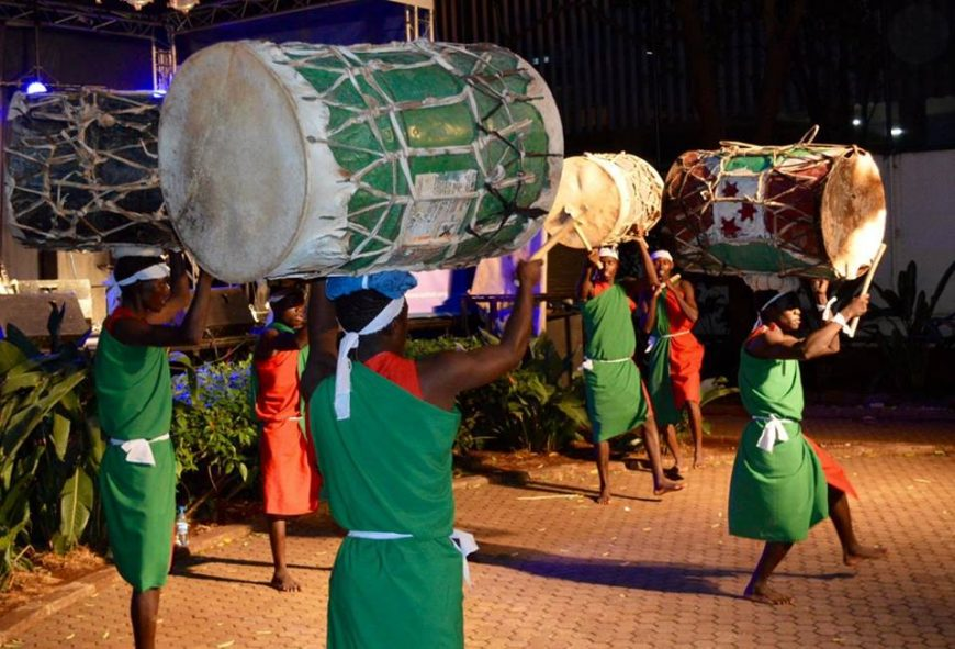 Drummers from Kakuma camp carry drums on their heads