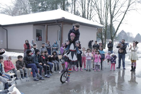 Bekah rides a unicycle in the Balkans