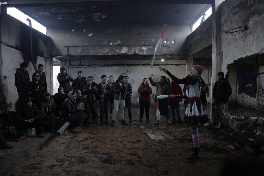 Bekha juggles in a cement bunker