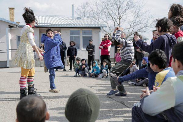 Kids dance during an outdoor performance