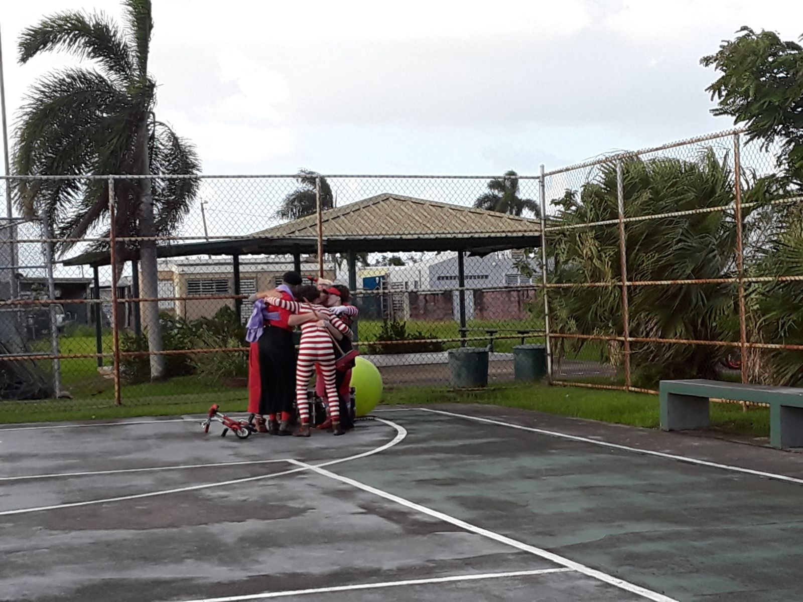The team hugs in Puerto Rico