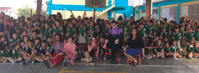Clowns and kids pose for a group shot in Puerto Rico
