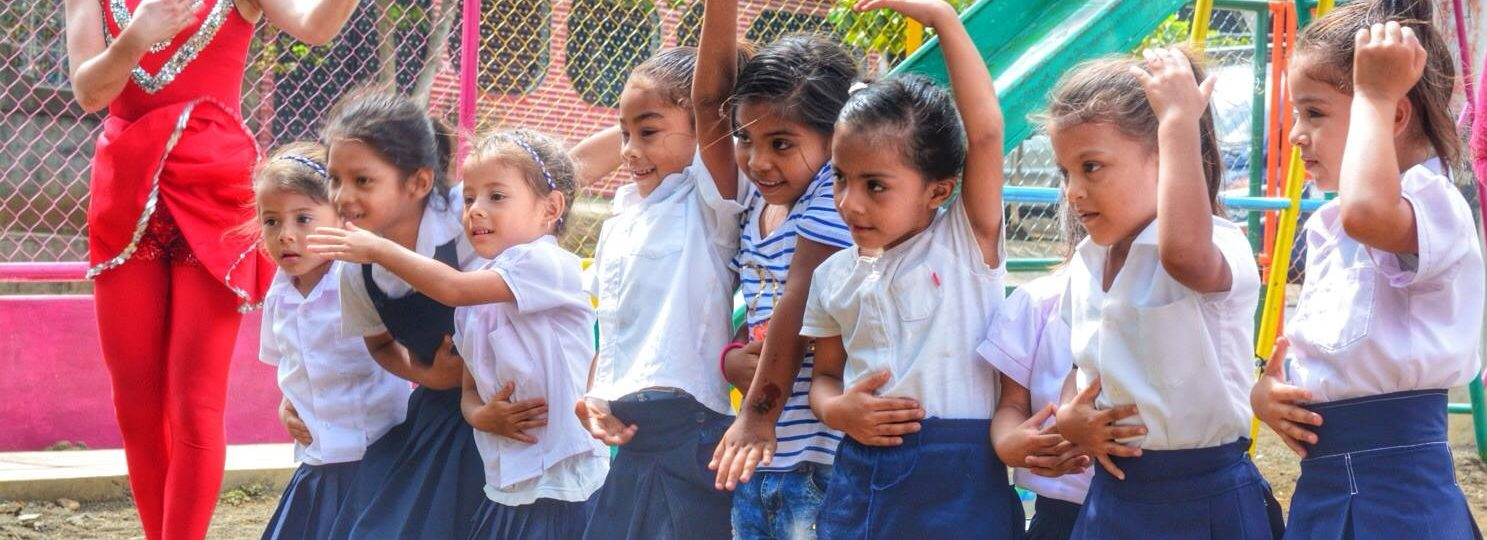 Little girls make shapes during a performance