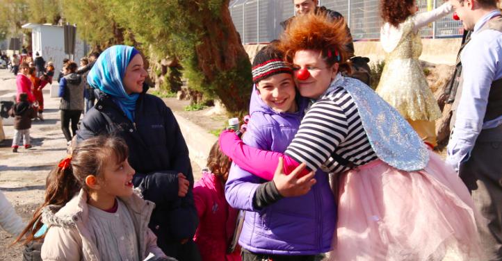 Kolleen hugs kids in Less
