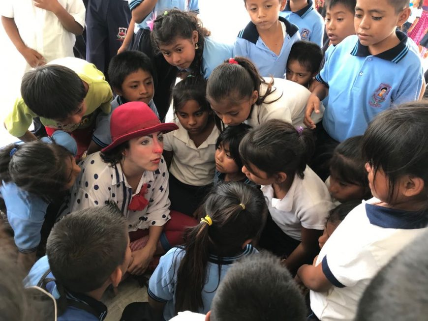 Aline is encircled by kids in Mexico