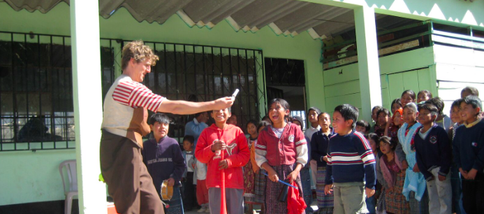 Leapin Louie with kids in Guatemala