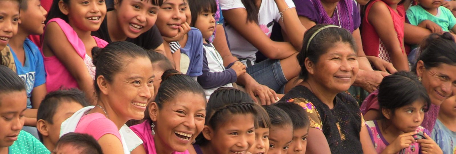 Parents and children laugh during a show in Mexico