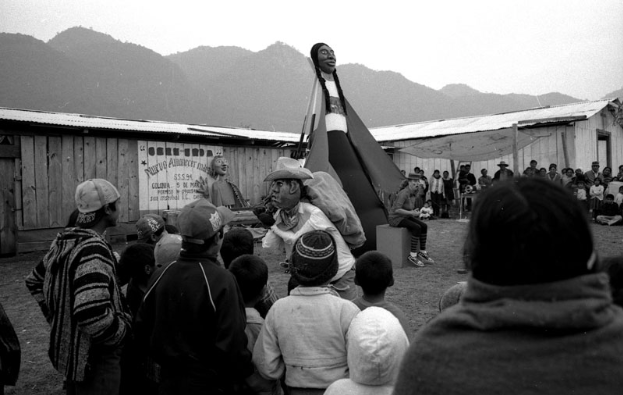 A crowd watches a giant handmade puppet, in Chiapas, MX