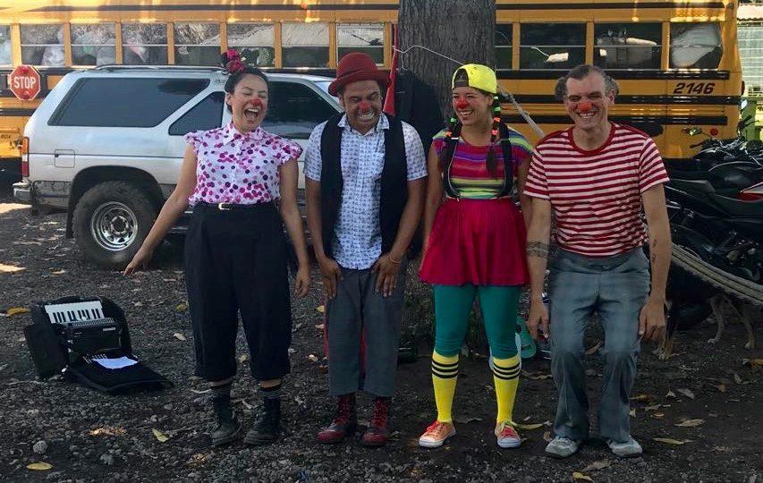 Four clowns take a bow