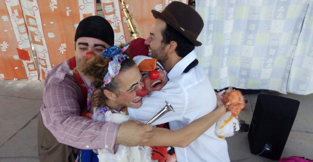 A group of clowns hug in Mexico