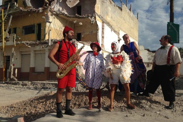 Clown band stands in the rubble