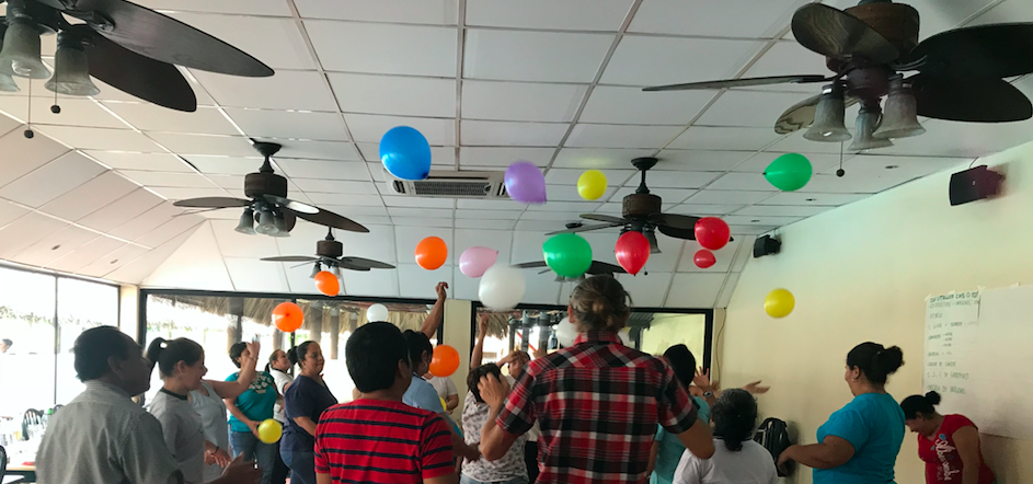 Workshop participants keep their balloons floating