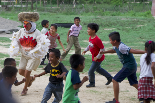 Darina chases children in her chicken costume