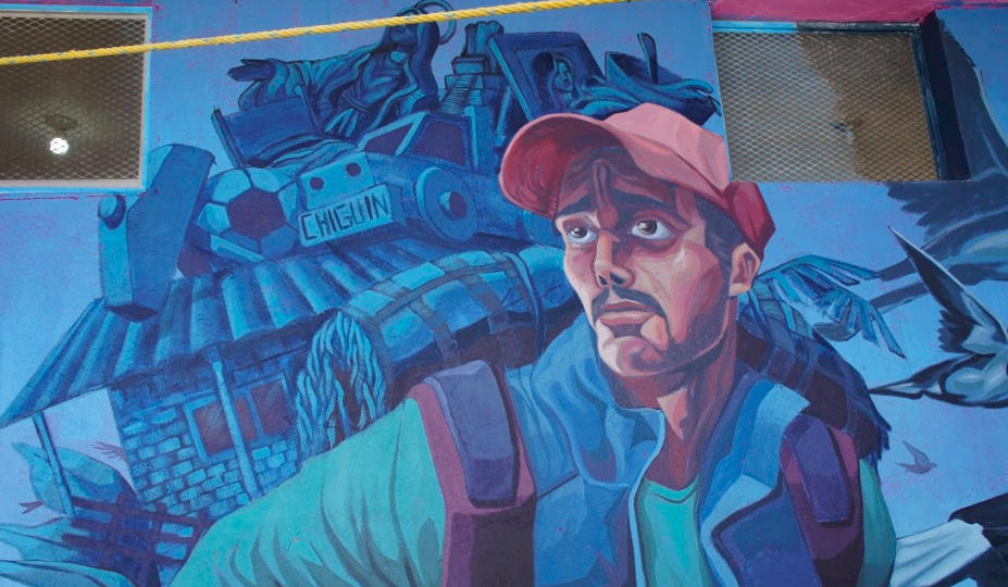 mural of migrant man