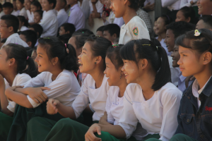 Girls laugh at a Clowns Without Borders show teaching mine risk education
