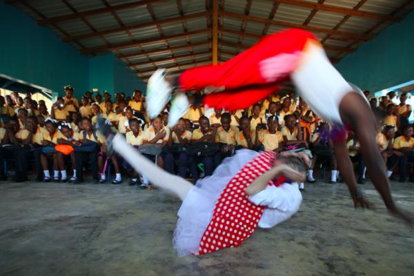 A Haitian artist jumps over Montana