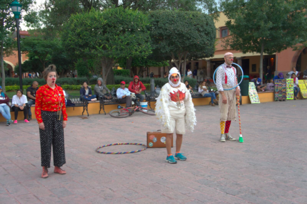 Clowns stand in the plaza