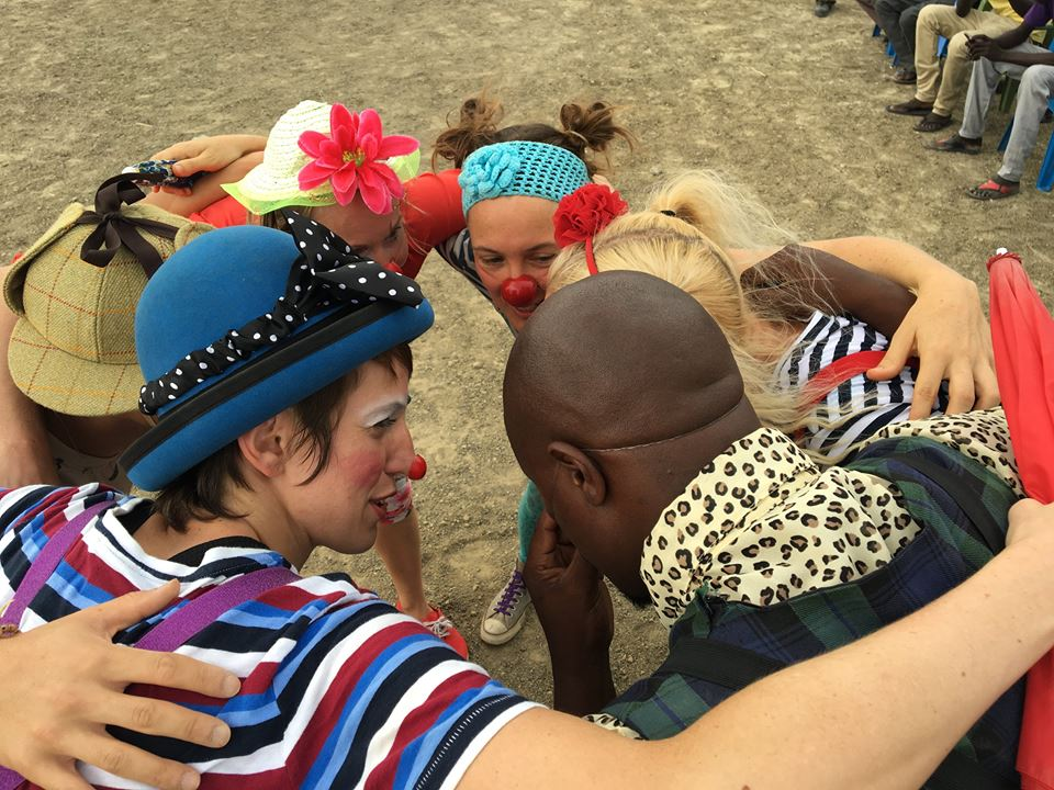 Clowns form a group hug before performing in South Sudan