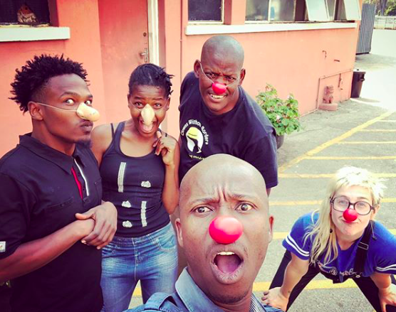 All the clowns make funny faces at the camera
